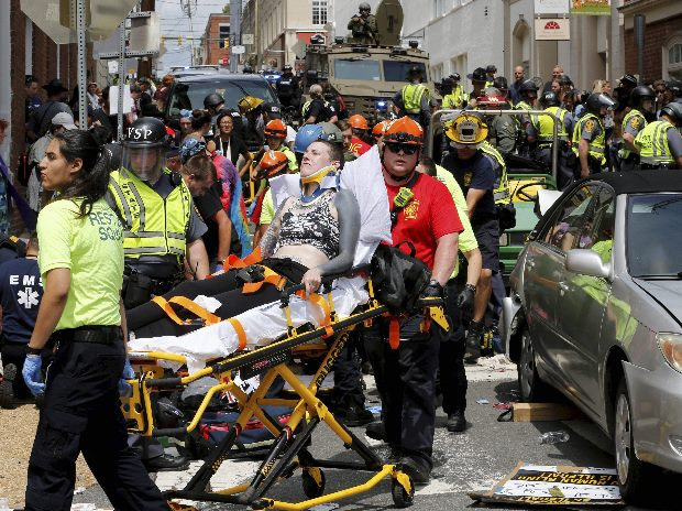 Rescue personnel help injured people after a car ran into a large group of protesters after a white nationalist rally in Charlottesville. File Photo: AP/PTI