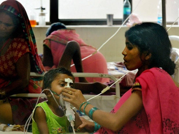 Children receive treatment in the Encephalitis  Ward at the Baba Raghav Das Medical College Hospital where over 60 children have died over the past one week, in Gorakhpur district. (Photo: PTI)