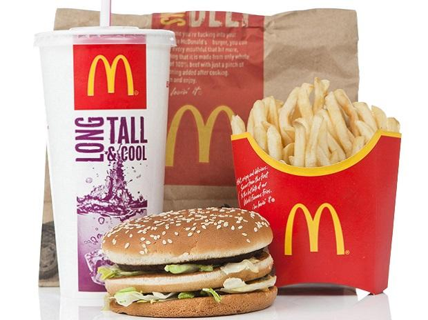McDonald's cutting cheeseburgers and chocolate milk from Happy Meals