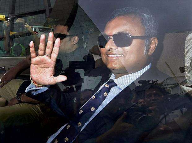 Karti Chidambaram, son of former Union minister P Chidambaram, waves as he arrives at Central Bureau of Investigation (CBI) headquarter in New Delhi on Wednesday in connection with INX Media case. (Photo: PTI)