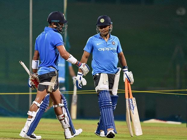 Skipper Virat Kohli and Mahendra Singh Dhoni during a practice session ahead of the second ODI match, in Kandy on Wednesday. (Photo: PTI)