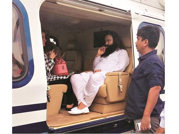 Dera Sacha Sauda chief Gurmeet Ram Rahim Singh in a helicopter in which he was flown from to Rohtak to be lodged in the district jail on Friday	 Photo: PTI