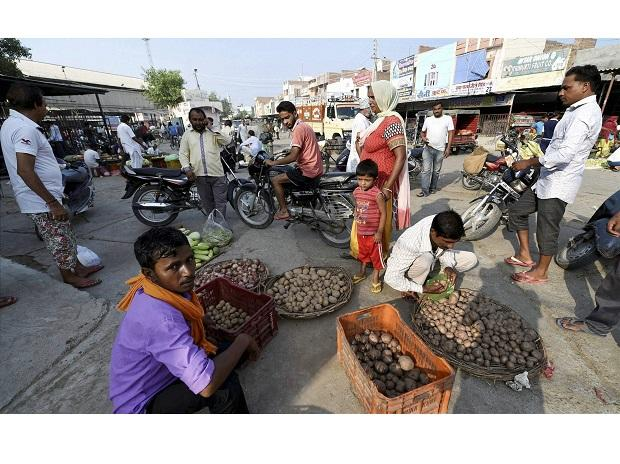 Locals in a vegetable market after relaxation in curfew in Sirsa on Sunday. Photo: PTI