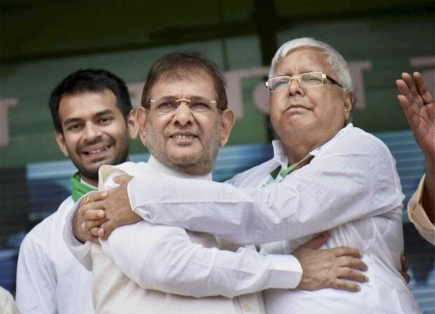 RJD chief Lalu Prasad Yadav with rebel Janata Dal-United (JD-U) leader Sharad Yadav during the  'BJP bhagao, desh bachao' rally at Gandhi Maidan in Patna on Sunday. Photo: PTI