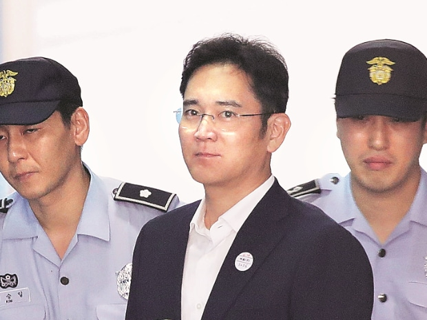 A South Korean court on Friday sentenced Lee Jae-yong (centre) to five years in jail.