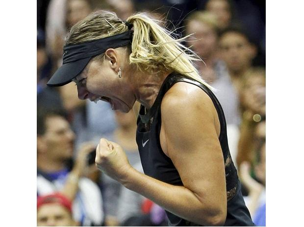 Maria Sharapova reacts after defeating Simona Halep 6-4, 4-6, 6-3 in their opening round match in the U.S. Open tennis tournament in New York. Photo: PTI/AP