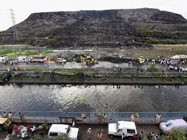 Rescue and relief operations underway after a part of the Ghazipur garbage landfill collapsed in east Delhi. Photo:PTI