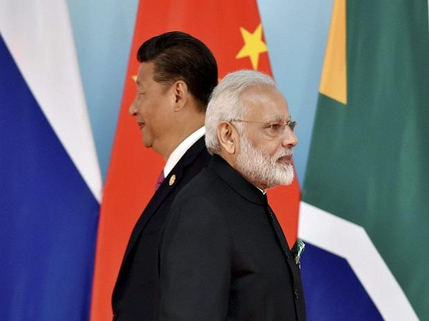 Xiamen: Chinese President Xi Jinping, left, and Indian Prime Minister Narendra Modi attend the group photo session at 2017 BRICS Summit in Xiamen, Fujian province in China, Monday, Sept. 4, 2017. AP/PTI