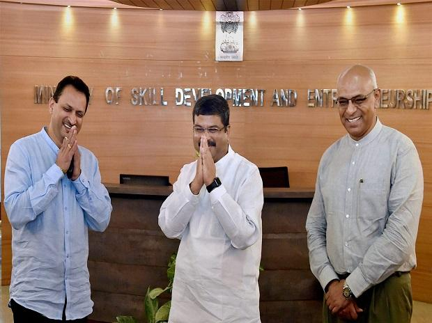 Newly appointed Minister for Petroleum and Natural Gas Dharmendra Pradhan and Minister of State Skill Development and Entrepreneurship  Anant Kumar Hegde arrives to assume charge of their portfolios at their ministry in New Delhi. Photo: PTI