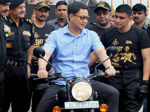 Gurugram: Union Minister for State Kiren Rijiju rides a bike during the flag off ceremony of the NSG Motorcycle Expedition-2017 at NSG campus in Gurugram on Thursday.  PTI Photo