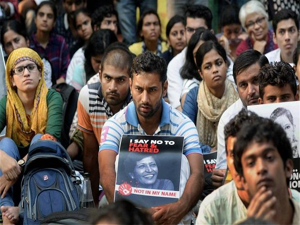 New Delhi: Demonstrators hold placards with the picture of  journalist Gauri Lankesh during a 'Not In My Name' protest,  at Jantar Mantar in New Delhi on Thursday. PTI Photo