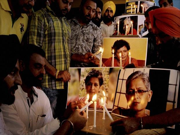 Amritsar: Members of the National Human Rights and Crime Control Organisation in a candle-light vigil in Amritsar on Friday, to condemn the killing of journalist Gauri Lankesh. PTI Photo