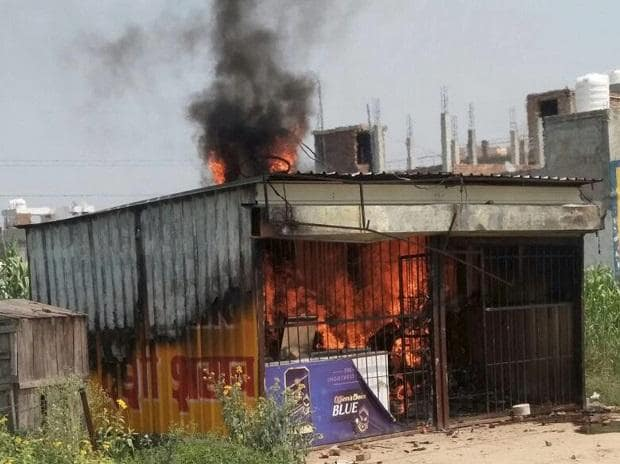 Protesters set ablaze the liquor shop close to the Ryan International School in Gurugram on Sunday, two days after a 7-year-old class II student of the school was brutally murdered. Photo: PTI