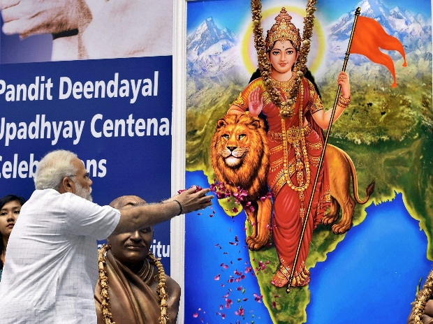 New Delhi: Prime Minister Narendra Modi paying tributes to Swami Vivekananda during a function on the occasion of  125th anniversary of Vivekananda's Chicago Address and birth centenary of Deendayal Upadhyay in New Delhi on Monday. PTI Photo