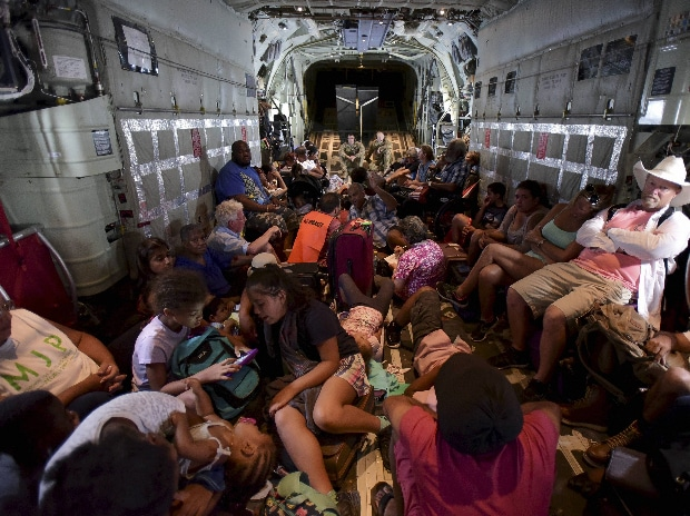 US Air force personnel evacuate citizens aboard an aircraft after the passage of Hurricane Irma, in St. Martin.(Photo: AP|PTI)