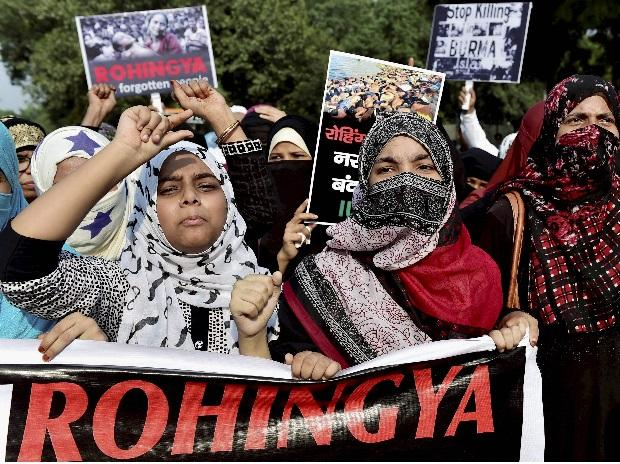 New Delhi: Muslims stage a rally to condemn ongoing violence against the Rohingya Muslims in Myanmar, near Myanmar Embassy in New Delhi on Wednesday. PTI Photo