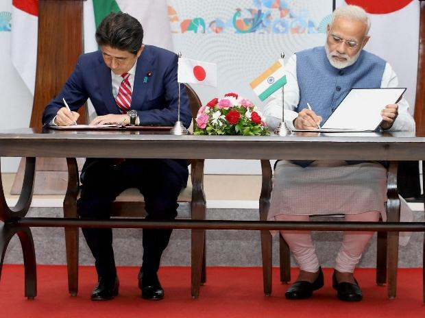 Prime Minister Narendra Modi and his Japanese counterpart Shinzo Abe sign an agreement documents during the India-Japan Annual Summit in Gandhinagar, Gujarat.