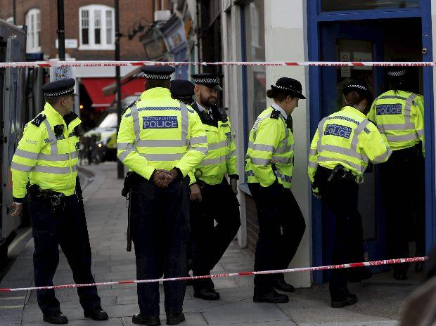 Police enter a building near Parsons Green subway station in London (Photo: AP/PTI)