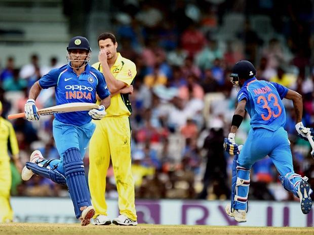 India's MS Dhoni and Hardik Pandya run between the wickets during the first  India-Australia One Day International (ODI) cricket match being played at the M A Chidhambaram stadium in Chennai on Sunday. Photo: PTI