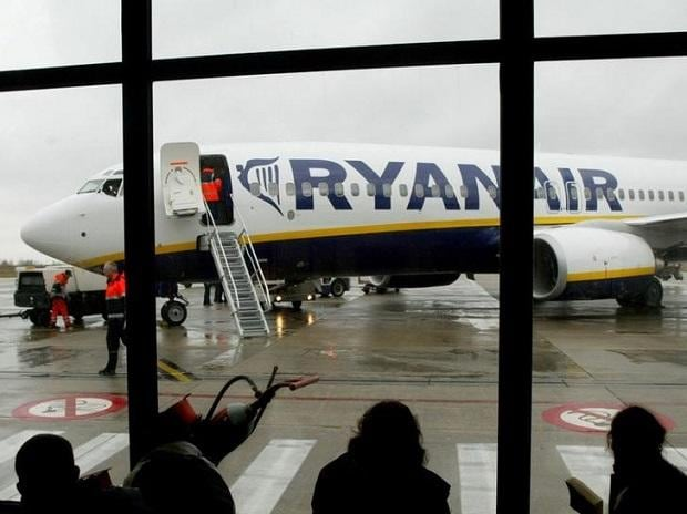 Travellers wait in front of a passenger jet belonging to Irish discount airline Ryanair at Charleroi airport in southern Belgium. Photo: Reuters