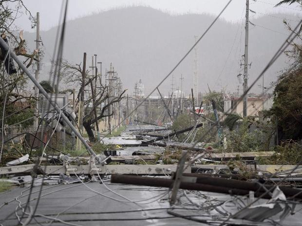 Humacao : Electricity poles and lines lay toppled on the road after Hurricane Maria hit the eastern region of the island, in Humacao, Puerto Rico. Photo: PTI