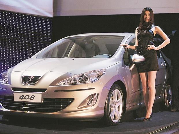 File photo of a Peugeot 408 at its global launch in Beijing. Photo: Reuters