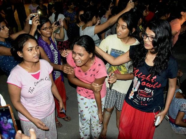 Varanasi: An injured student writhing in pain after police allegedly beat them up during a clash at Banaras Hindu University. Photo: PTI