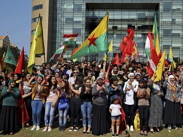 Supporters of the Kurdistan Workers' Party, known as the PKK, chant slogans as they take part in a demonstration demanding the release of Kurdish guerrilla leader Abdullah Ocalan, in front of the United Nations Headquarters in Beirut. Photo: AP/PTI
