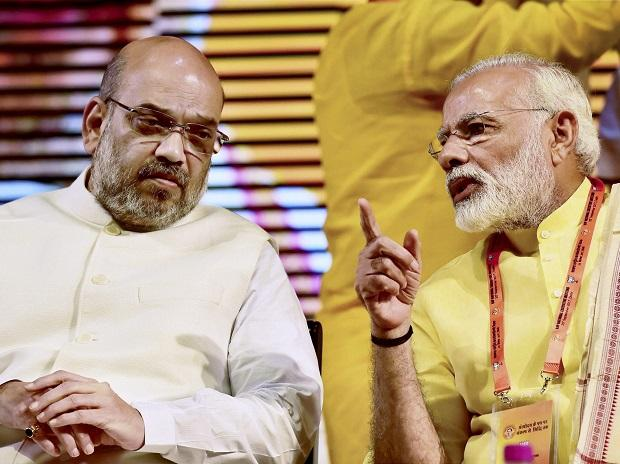 File photo of BJP Party President Amit Shah with Prime Minister Narendra Modi. Photo: PTI