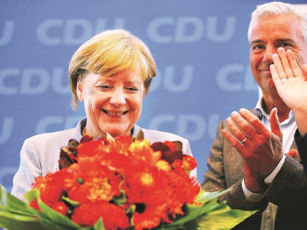 Merkel presses SPD for coalition talks, says European Union  needs stable German govt
