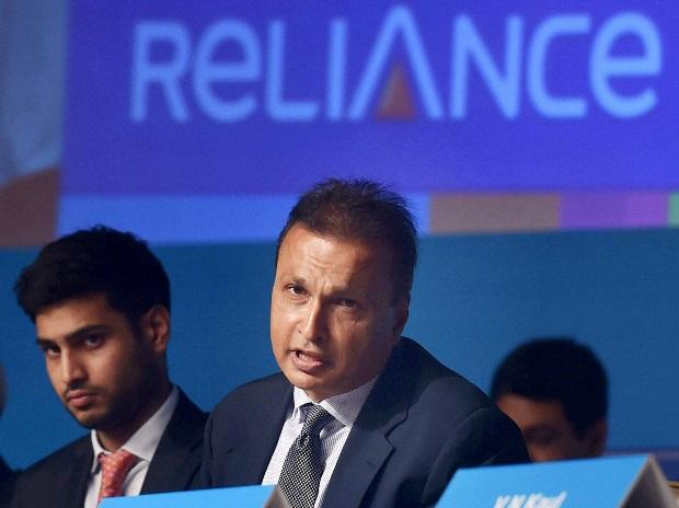 Reliance Group Chairman Anil Ambani with his son Anmol addresses the Annual General Meeting of Reliance Capital in Mumbai. File photo: PTI