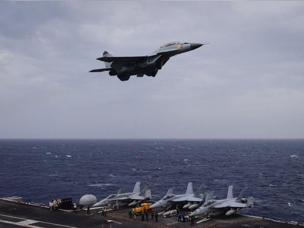 An Indian Navy MiG 29K on a low pass over the deck of USS Nimitz during Malabar 2017. Photo: @indiannavy