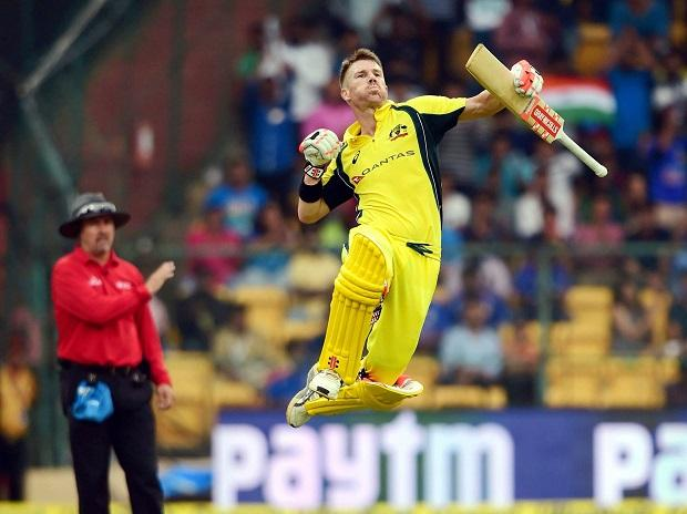 Australia's David Warner jumps in the air after scoring his hundred runs during the 4th ODI cricket match against India. Photo: PTI