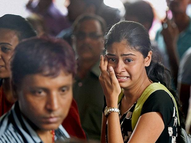 Relatives of the stampede victims near the mortuary of a hospital in Mumbai. (Photo: PTI)