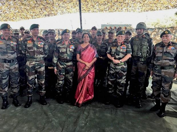 Defence Minister Nirmala Sitharaman and Chief of the Army Staff General Bipin Rawat with the troops at one of the forward area posts in Jammu and Kashmir. | PTI Photo/ Twitter