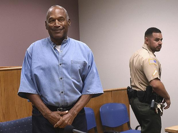 File photo of former NFL football star O J Simpson as he enters for his parole hearing at the Lovelock Correctional Center in Nevada. (Photo: PTI)