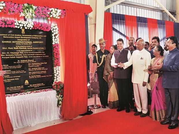 President Ram Nath Kovind unveils a plaque for the inauguration of the Shirdi International Airport in Shirdi, Maharashtra, on Sunday. Maharashtra Governor C Vidyasagar Rao and  Chief Minister Devendra Fadnavis are also seen   	photo: pti