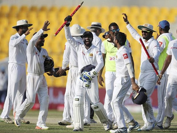 Sri Lanka players celebrate after they beat Pakistan during their fifth day at First Test cricket match in Abu Dhabi. Photo: PTI
