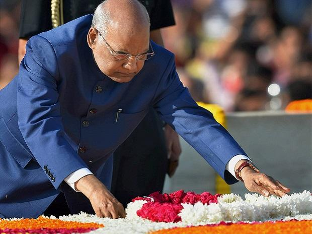 President Ram Nath Kovind pays floral tributes to Mahatma Gandhi, the father of the nation, on his 148th birth anniversary at Rajghat. Photo: PTI