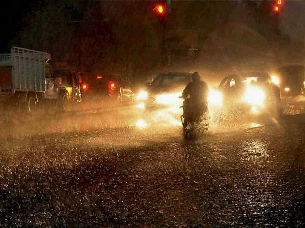 People commute in heavy rains in Hyderabad. Photo: PTI
