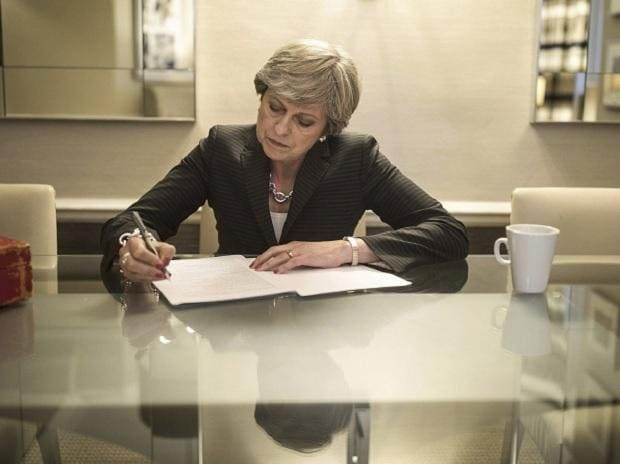 Britain's Prime Minister Theresa May prepares her speech that she will deliver Wednesday at the Conservative party conference, at the Manchester Central Convention Complex in Manchester, England. (Photo: AP| PTI)
