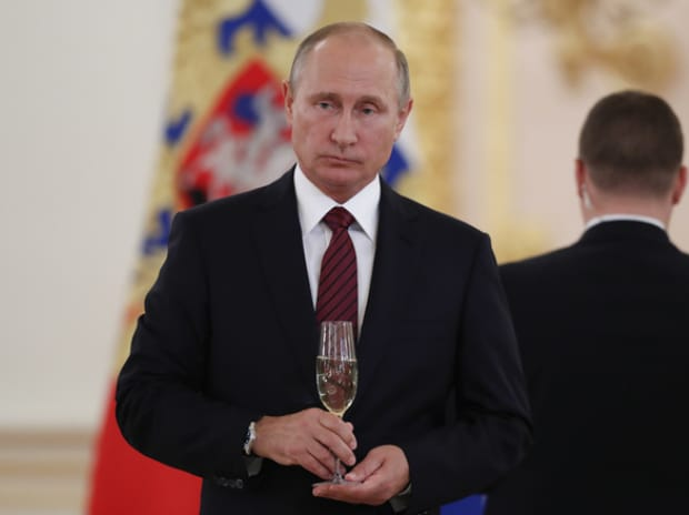 Russian President Vladimir Putin holds a glass of champagne during a ceremony to receive credentials from foreign ambassadors at the Kremlin in Moscow.(Photo: Reuters)