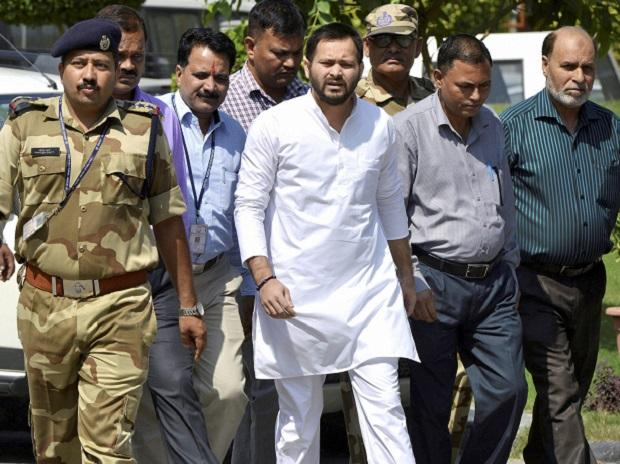 Former Bihar deputy CM Tejashwi Yadav arrives at the CBI headquarters for questioning in connection with an alleged case of corruption in awarding a maintenance contract for two IRCTC hotels to a private firm, in New Delhi.( Photo: PTI)