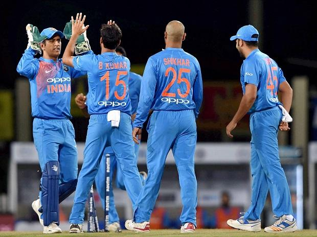 Indian bowler B.Kumar celebrates with his teammates after dismissing Australian batsman D.Warner during the 1st T20 cricket match between India and Australia in Ranchi. Photo: PTI