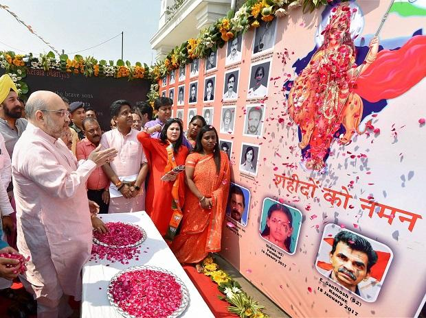 BJP President Amit Shah pays homage to party workers those allegedly murdered in Kerala, during 'Jan Raksha Yatra' in New Delhi on Sunday. Photo: PTI