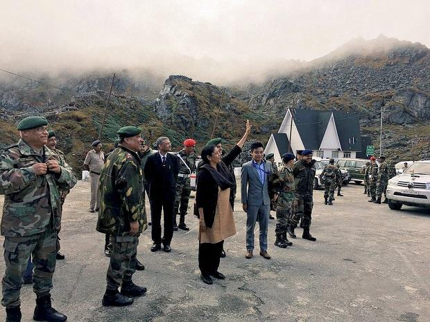 Union Defence Minister Nirmala Sitharaman acknowledging a row of Chinese soldiers from across the fence who were taking pictures on her reaching Nathu La. Photo: PTI