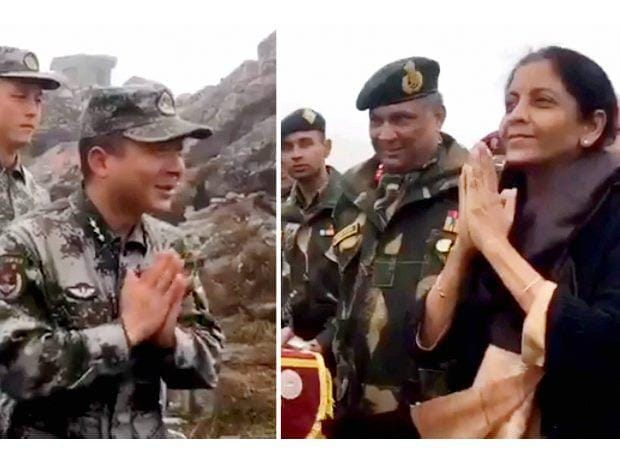 In this combo picture of the two stills taken from a video snippet posted by Defence Minister Nirmala Sitharaman, she is seen interacting with the Chinese soldiers at the border at Nathu-la in Sikkim on Saturday. PTI Photo/ Twitter @nsitharaman