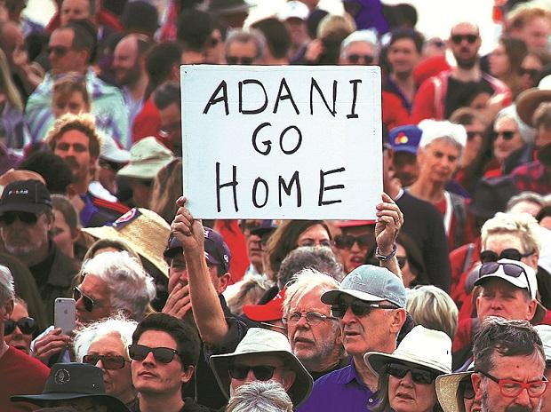People protesting against Adani's Carmichael coal mine project, at Bondi Beach in Australia. 	Photo: Reuters