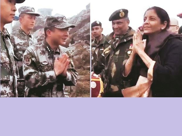 Defence Minister Nirmala Sitharaman is seen interacting with Chinese soldiers at Nathu-la border in Sikkim on Saturday. Photo: PTI