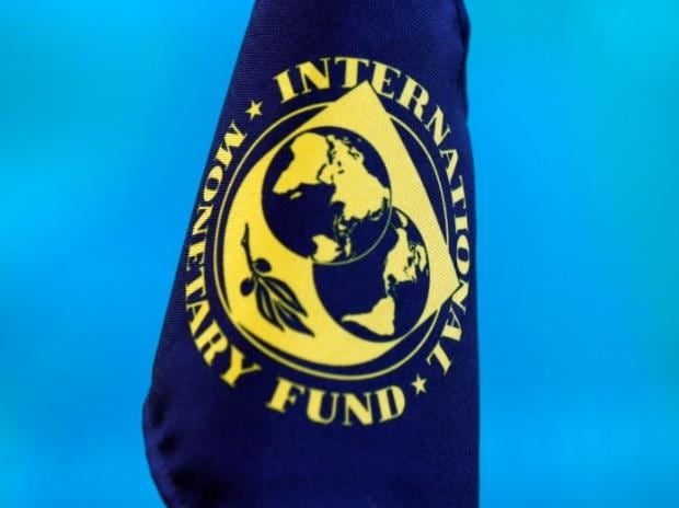 The flag of the International Monetary Fund is pictured at a news conference. Photo: Reuters